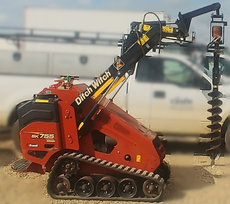 Mini-skid-steer-with-post-hole-auger